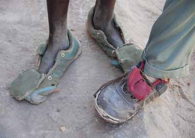 Children's feet in worn out shoes